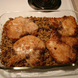 Baked Pork Loin Chops With Orange Rice.
