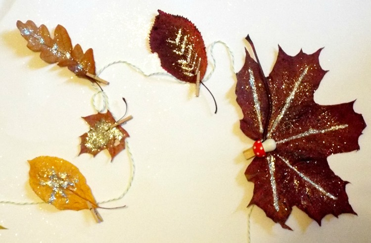 glittery leaves pegged to twine