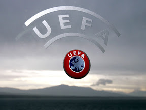 A UEFA logo is seen with Geneva Lake and Alps as background 08 December 2006 during a press conference closing a two days Executive committee meeting of the European football federation at the headquarters in Nyon. AFP PHOTO / FABRICE COFFRINI