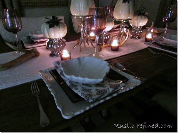 A Fall Night Tablescape using antlers, white dishes and gorgeous ceramic pumpkins