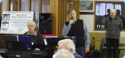 Peter Brophy and Len Hancy entertaining the members with a sing-along session. With George Watt in the background
