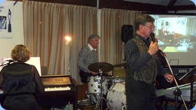 The Music Makers Band in full swing. Left to Right: Carole Littlejohn, Ian Jackson, Len Hancy, and Peter Brophy (partially obscured).