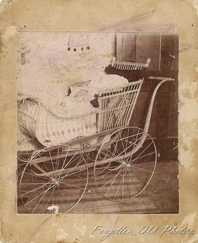Baby stroller defaced with crayon DL Antiques