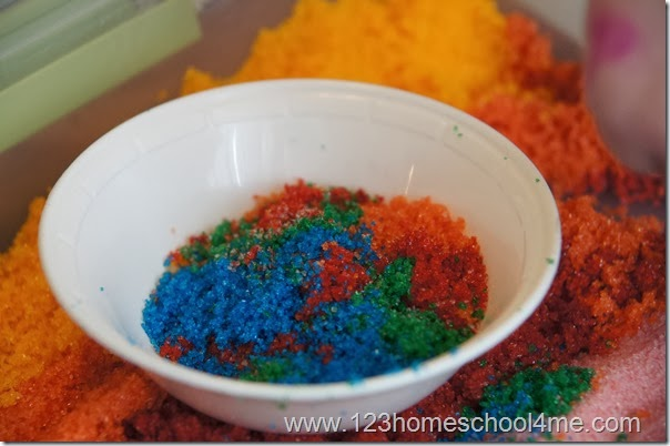 Homemade sand is even beautiful when the colors mix.