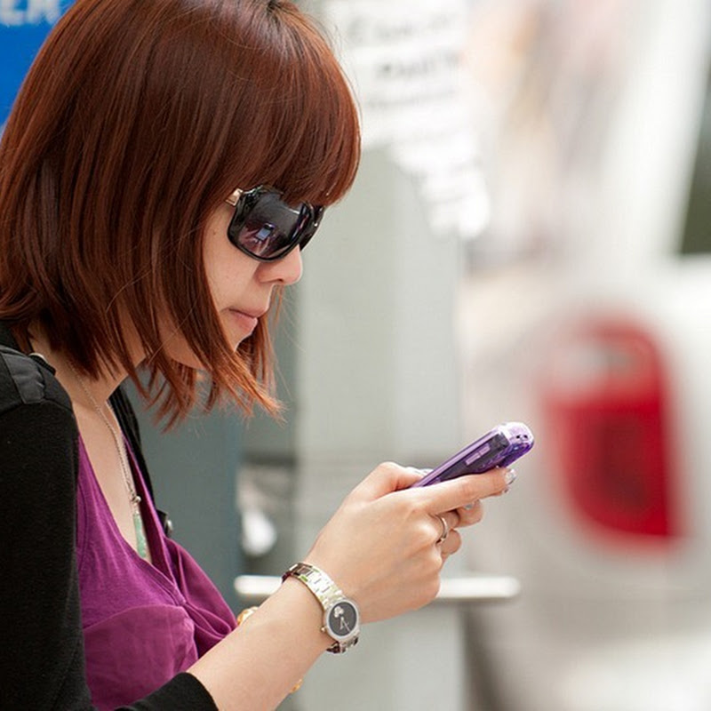 Photographs of People Texting in the Streets