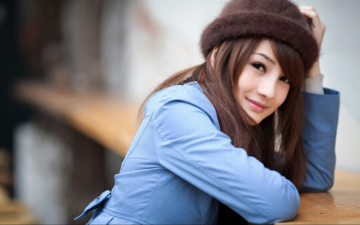 Cute Girl wearing Blue Jacket & Brown Cap