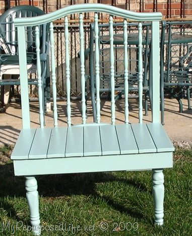 upcycled crib into a green bench