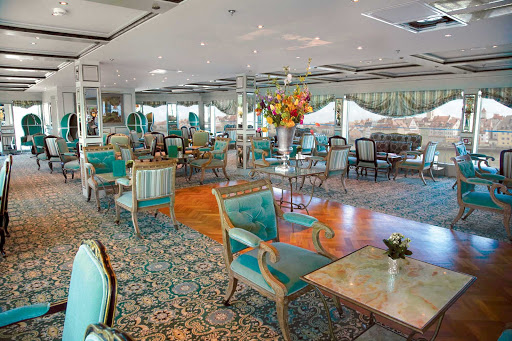 The S.S. Antoinette's Salon du Grand Trianon is ideally positioned for you to admire the breathtaking vistas of the Rhine River.