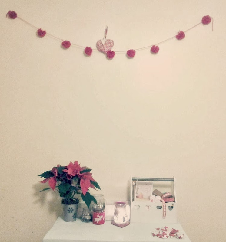red yarn pom pom garland