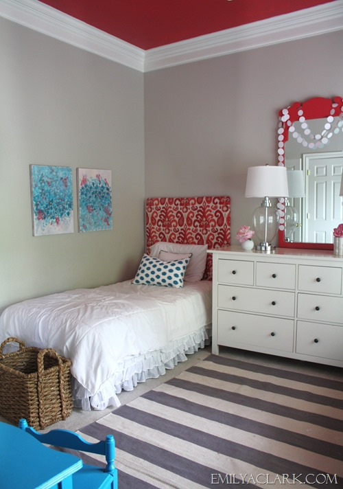 girls bedroom with ikat headboard, striped rug and painted ceiling