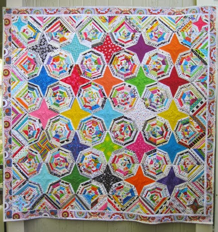 fun and bright Spider Web Selvage quilt by Kelly Girl Quilts