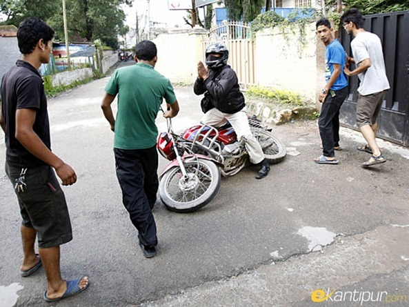 A-motorcycle-rider-pleads-to-a-group-of-protestors-to-spare-his-vehicle-during-a-strike-called-in-Lalitpur-district-Nepal