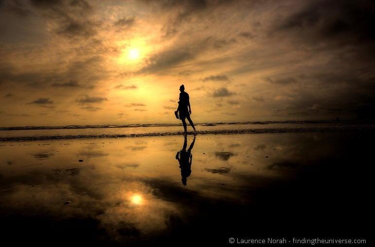 Girl at sunset reflection Canoa Ecuador 2