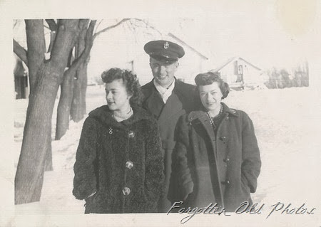 Navy and two gals Moorhead Antiques Developed May 27 1943 Minneapolis