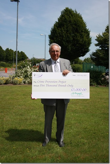 John Dwyer with cheque for Crime Prevention Fund