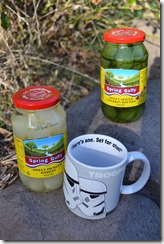 Two jars of pickles and a Storm Trooper mug