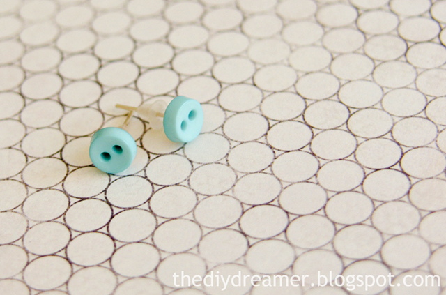 feature button earrings