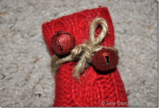 Tie-twine-and-bells-around-stocking