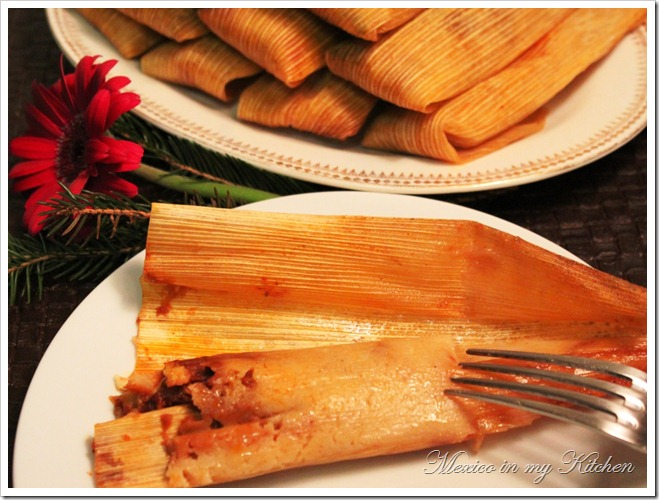 cooked pork tamales in a corn husk