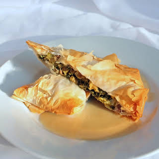 Wild Mushroom, Swiss Chard & Goat Cheese Strudels with Bourbon Cider Sauce.