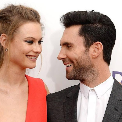 Gwen Stefani says Adam Levine can't stop showing his daughter off