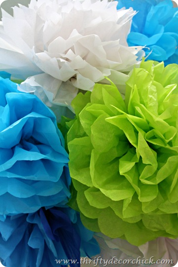 green blue white tissue poms