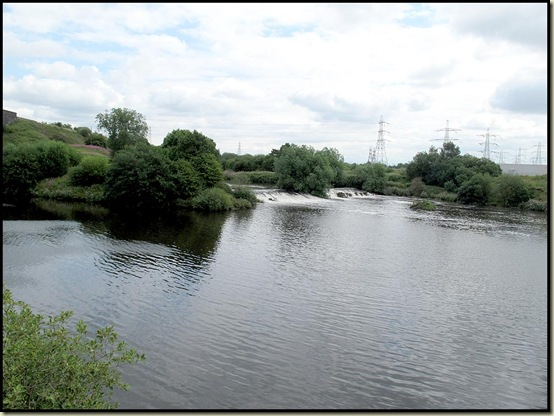The River Mersey drains into the Manchester Ship Canal at Irlam