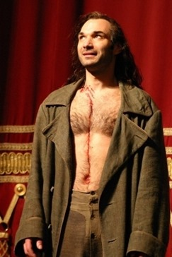 Nikolai Schukoff at the curtain call after a 2008 Bayerische Staatsoper PARSIFAL, in which he sang the title rôle [Photo used with the artist's permission; photographer uncredited]