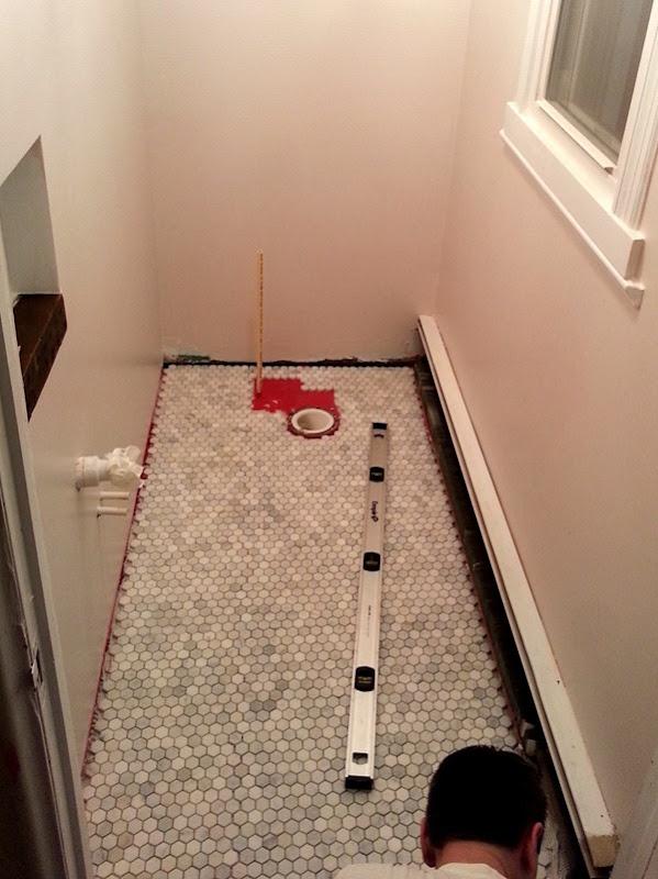 Marble tile floor in powder room