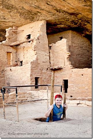 boy on kiva ladder Mesa Verde - photo by Adrienne zwart