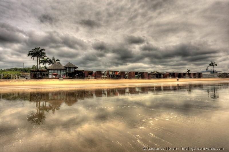 Playa montanita houses reflected in beach