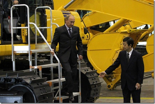 YAROSLAVL, RUSSIA - JUNE 18:  Russian Prime Minister Vladimir Putin (L) is guided by Yasuhisa Tsukamoto, Director General of the Komatsu Company in Russia, while visiting the KMR plant, a new assembly plant of Komatsu Manufacturing, June 18, 2010 in Yaroslavl, Russia. KMR is Komatsu's first assembly plant in Russia for construction and mining equipment.  (Photo by Sasha Mordovets/Getty Images)