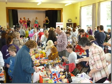 Fete - inside the Church hall - Zumba on stage and various stalls