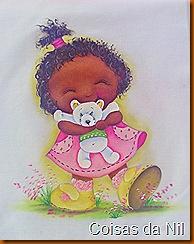 menina negra com ursinho