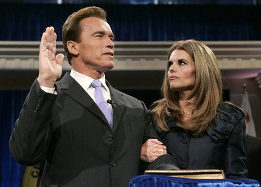 File photo of California Governor Arnold Schwarzenegger taking oath of office in Sacramento...California Governor Arnold Schwarzenegger is joined by his wife Maria Shriver while being sworn into office for a second term by Supreme Court Chief Justice Ronald George during his inauguration ceremony at the Memorial Auditorium in Sacramento, California in this January 5, 2007 file photo. The former California first lady has moved out after 25 years of marriage, reported Los Angeles Times. The couple confirmed their separation in a joint statement released on May 9, 2011 after questions were raised by The Times.  REUTERS/Rich Pedroncelli/Pool/Files  (UNITED STATES - Tags: POLITICS ENTERTAINMENT)