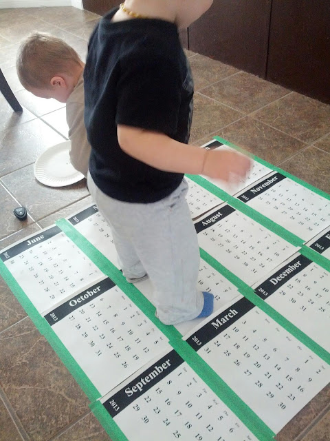 Toddler doing a calendar activity