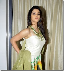 Actress Madhurima New Photos in Sleeveless White Long Dress