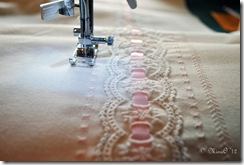 The flounce with the lace inserted and the embroidery being stitched on each side of the lace.