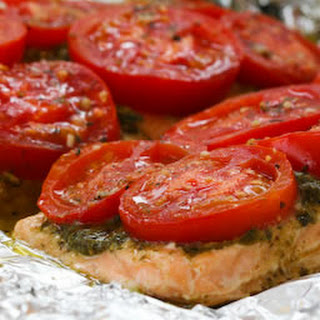 Foil-Baked Salmon with Basil Pesto and Tomatoes.