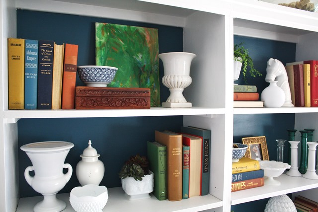 bookshelves styled with kids' abstract painting