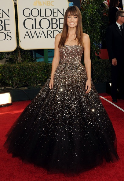 ene11-Olivia Wilde arrives at the 68th Annual Golden Globe Awards
