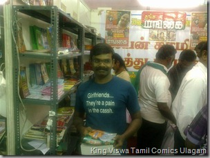 CBF Day 13 Photo 47 Stall No 372 Regular comics reader Artist Bala Sir Buying Comics