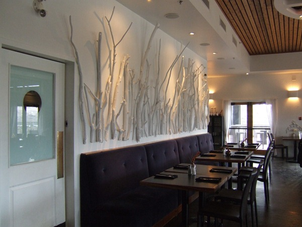 Branch wall and mint painted glass door (Mica Restaurant via Little Victorian)