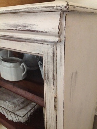 pretty white distressed cabinet