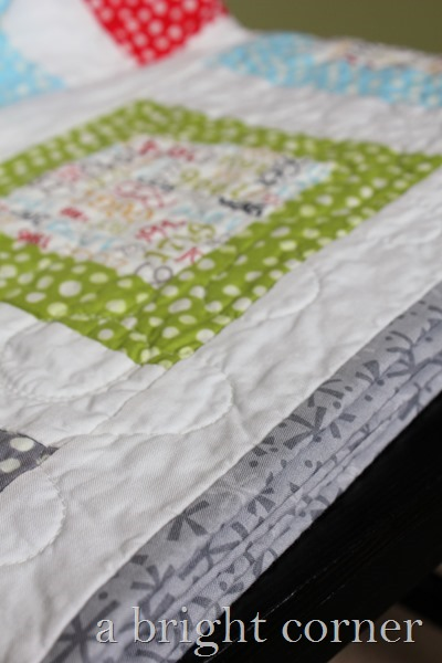 fun and bright throw quilt by A Bright Corner