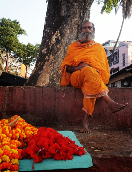 Hindu holy man selling flowers outside Kamakhya Temple. Guwahati.