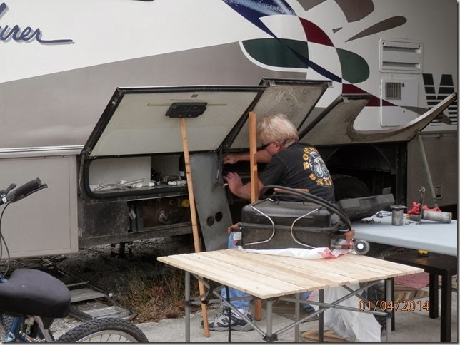 Gary doing repairs on the Furnace on his Coach