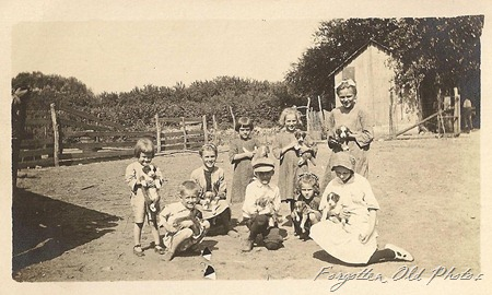 Azo Postcard Triangles Up Kids and nine puppies Perham