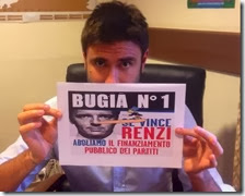 Di Battista con il cartello anti Renzi