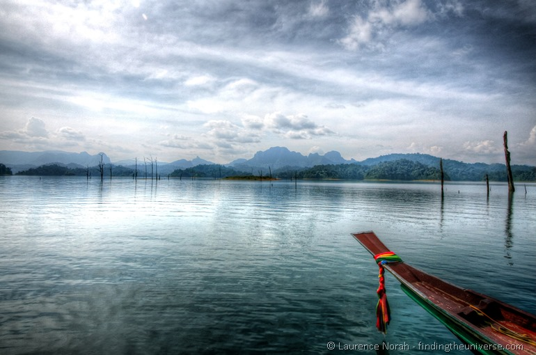 Khao Sok National Park Chiao Lan Resevoir long tail boat clouds sky reflection